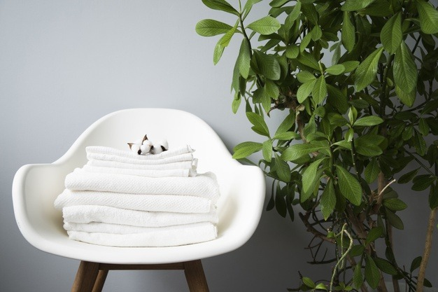 front-view-pile-towels-chair_23-2148251750